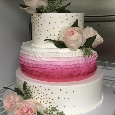 White, Pink Ruffles, and Gold Wedding Cake