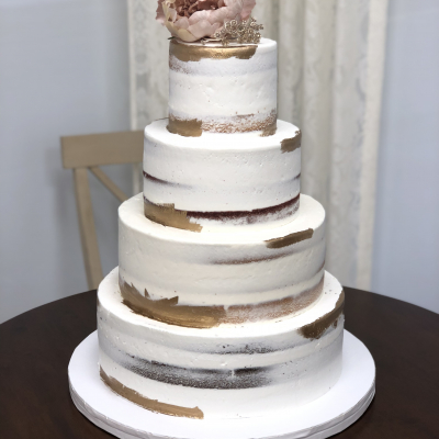 Naked Wedding Cake with Gold Accents