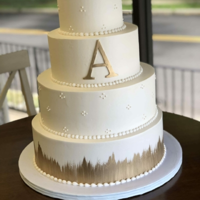 Simple Gold and White Monogram Cake