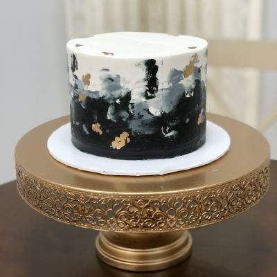 Black and Gray Spackled Buttercream Cake